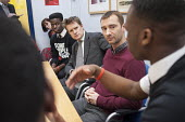 Campaigner Charlie Condou with Tristram Hunt MP visiting Little Ilford School in Newham, London, to discuss the school's work with Stonewall on its campaign against homophobic bullying. - Philip Wolmuth - ,2010s,2015,against,anti gay,antigay,BAME,BAMEs,Black,BME,bmes,campaign,campaigning,CAMPAIGNS,child,CHILDHOOD,children,communicating,communication,conversation,conversations,democracy,dialogue,discour