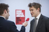 A journalist interviews Tristram Hunt MP visiting Little Ilford School in Newham, London, to discuss the schools work with Stonewall on its campaign against homophobic bullying. - Philip Wolmuth - 2010s,2015,against,anti gay,antigay,campaign,campaigning,CAMPAIGNS,democracy,election,elections,equal,equality,General Election,Homophobia,HOMOSEXUAL,Homosexuality,HOMOSEXUALS,INEQUALITY,interview,INT