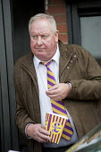 A local UKIP supporter eating UKIP popcorn outside the Movie Starr cinema, Canvey Island, South Essex, following the launch of the party's General Election campaign. - Philip Wolmuth - ,2010s,2015,campaign,campaigning,CAMPAIGNS,cinema,DEMOCRACY,eating,Election,elections,Essex,eurosceptic,Euroscepticism,eurosceptics,food,FOODS,General Election,launch,local,male,man,men,outside,people