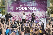 Podemos presidential candidate Teresa Rodriguez and sec gen Pablo Iglesias at a rally in Malaga a week before Andalusian parliamentary elections in which the grassroots party is hoping to make signifi... - Philip Wolmuth - 2010s,2015,Andalusia,campaign,campaigning,CAMPAIGNS,candidate,candidates,democracy,Election,elections,eu,european,europeans,eurozone,FEMALE,party,people,person,persons,Podemos Party,POL,political,POLI