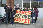 Homes before Profit. Housing campaigners and former residents of the Sweets Way estate in Whetstone, Barnet, London, hand out leaflets in Whetstone to demand rehousing closer to schools, family and fr... - Philip Wolmuth - 21-03-2015