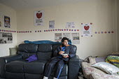 Abdou Guernaoui (aged 14) at a house occupied by housing campaigners on the Sweets Way estate in Whetstone, Barnet, London. His family was evicted from their former home on the estate and placed in em... - Philip Wolmuth - 2010s,2015,accommodation,activist,activists,against,CAMPAIGN,campaigner,campaigners,CAMPAIGNING,CAMPAIGNS,council,Council Services,Council Services,DEMONSTRATING,demonstration,DEMONSTRATIONS,emergency