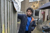Abdou Guernaoui (aged 14) at a house occupied by housing campaigners on the Sweets Way estate in Whetstone, Barnet, London. His family was evicted from their former home on the estate and placed in em... - Philip Wolmuth - ,2010s,2015,accommodation,activist,activists,against,CAMPAIGN,campaigner,campaigners,CAMPAIGNING,CAMPAIGNS,council,Council Services,Council Services,DEMONSTRATING,demonstration,DEMONSTRATIONS,emergenc