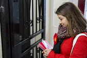 General election 2015: Tulip Siddiq, Labour candidate for Hampstead & Kilburn, the second most marginal seat in the UK, canvassing voters in a social housing block in Swiss Cottage, London. - Philip Wolmuth - 2010s,2015,activist,activists,campaign,campaigner,campaigners,campaigning,CAMPAIGNS,candidate,candidates,CANVASING,canvassing,Cottage,COTTAGES,democracy,election,elections,FEMALE,General Election,hous