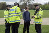 Police cautioning a user. Anyone found in possession of drugs faces arrest and prosecution. Legalise Legalise Cannabis Day, an annual 4/20 event in the campaign to legalise use rather than prohibition... - Philip Wolmuth - 2010s,2015,activist,activists,adult,adults,and,CAMPAIGN,campaigner,campaigners,CAMPAIGNING,CAMPAIGNS,Cannabis,CLJ,crime,DEMONSTRATING,demonstration,DEMONSTRATIONS,dope,drug,drugs,force,illegal,legalis