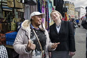 Green Party leader Natalie Bennett, with a stall holder at Ridley Road market, Dalston, London. - Philip Wolmuth - ,2010s,2015,BAME,BAMEs,Black,BME,bmes,campaign,campaigning,CAMPAIGNS,CANVASING,canvassing,cities,city,communicating,communication,conversation,conversations,democracy,dialogue,discourse,discuss,discus
