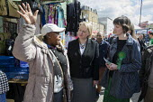 Charlotte George, Green Party parliamentary candidate for Hackney South and Shoreditch, with party leader Natalie Bennett, Ridley Road market, Dalston, London. - Philip Wolmuth - 2010s,2015,BAME,BAMEs,Black,BME,bmes,campaign,campaigning,CAMPAIGNS,candidate,candidates,CANVASING,canvassing,cities,city,communicating,communication,conversation,conversations,democracy,dialogue,disc