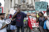 Residents of Cressingham Gardens Estate in Brixton, London, demonstrate outside Lambeth Town Hall over council plans to demolish their homes and build new housing which they believe will be unaffordab... - Philip Wolmuth - 13-07-2015