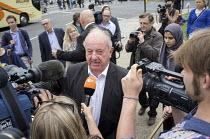 Poles protest anti migrant racism Parliament Square London Polish prince John Zylinski media interview - Philip Wolmuth - 20-08-2015
