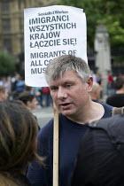 Poles protest anti migrant racism Parliament Square London - Philip Wolmuth - 20-08-2015