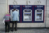A man and a woman at a NatWest cash machine London - Philip Wolmuth - 27-08-2015