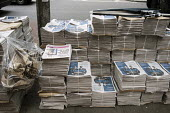 Evening Standard stacked on the street for distribution at Holborn station London - Philip Wolmuth - 08-09-2015