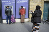 NatWest ATM in Whitechapel London, which has the largest Muslim community in the UK - Philip Wolmuth - 23-09-2015