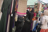 Whitechapel market serves the largest Muslim community in the UK, East London - Philip Wolmuth - 2010s,2015,BAME,BAMEs,black,bme,BME black,bmes,bought,business,buy,buyer,buyers,buying,choice,choosing,clothes clothing,commodities,commodity,communities,community,consumer,consumers,consumption,cultu