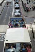 Tourist sightseeing on an open top bus in the City of London - Philip Wolmuth - 23-09-2015