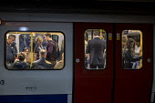 Crowded rush hour tube train carriage, London underground - Philip Wolmuth - 01-10-2015