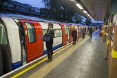 Passengers wait to board a tube train at a London Underground station - Philip Wolmuth - 05-10-2015
