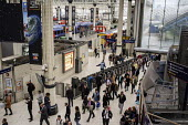 Passengers pass through ticket barriers at London Waterloo Station - Philip Wolmuth - 08-10-2015
