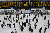Passengers waiting for trains at London Waterloo station - Philip Wolmuth - 08-10-2015