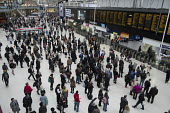 Passengers waiting for trains at London Waterloo station - Philip Wolmuth - ,2010s,2015,boards,busy,cities,City,departure,departures,EBF,Economic,Economy,infrastructure,journey,journeys,London,passenger,passengers,people,public,RAIL,railway,RAILWAYS,Rush Hour,station,STATIONS