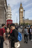 Tourists with camera by red phone box and Big Ben London Parliament Square - Philip Wolmuth - &,2010s,2015,adult,adults,amateur,Amateur Photographer,asian,asians,BAME,BAMEs,BME,bmes,box,boxes,BT,camera,cameras,chinese,cities,City,communicating,communication,couple,COUPLES,diversity,ethnic,ethn