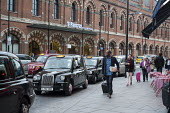 Black cab taxis queue for passengers at a taxi rank, St Pancras station London - Philip Wolmuth - 16-10-2015