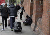 A homeless man begging on a street in Kings Cross London - Philip Wolmuth - 2010s,2015,baggar,beg,beggar,beggars,BEGGER,begging,begs,cities,City,EQUALITY,excluded,exclusion,FEMALE,HARDSHIP,home,homeless,homelessness,housing,impoverished,impoverishment,INEQUALITY,London,male,m