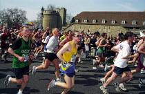 Runners passing the Tower of London, 2003 London Marathon - Joanne O'Brien - 2000s,2003,cities,city,exercise,exercises,feet,flora,LFL lifestyle & leisure,London,Marathon,run,Runner,Runners,Running,spo sport,urban