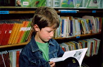 Boy using local library Haringey - Joanne O'Brien - 2000s,2003,book,books,bookshelf,bookshelves,Boy,Boys,child,CHILDHOOD,children,communicating,communication,council,EDU Education,juvenile,juveniles,kid,kids,libraries,Library,literature,local,Local Aut