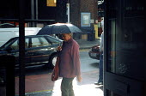 April showers - Joanne O'Brien - 2000s,2003,of,precipitation,Rain,raining,Shower,Showers,Umbrella,Umbrellas,WEA weather