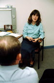 Patient with muscular dystrophy at Guy's Hospital with doctor - Joanne O'Brien - 20021024