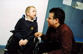 Boy with muscular dystrophy at Guy's Hospital and family care officer. - Joanne O'Brien - 20021024
