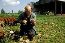 Mixed farmer tending to bees - Joanne O'Brien - 20021024