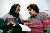 Doctor (left) with patient in refugee centre Newham East London - Joanne O'Brien - 20021024