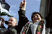 Labour MP and Leila Khaled famous Palestinian guerilla fighter from the 1960's and 70's at Palestine solidarity rally - Paul Mattsson - 2000s,2002,activist,activists,armed,CAMPAIGN,campaigner,campaigners,CAMPAIGNING,CAMPAIGNS,DEMONSTRATING,demonstration,DEMONSTRATIONS,FEMALE,Guerilla,Guerillas,Guerrilla,Guerrillas,Labour,MP.s,Palestin