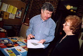 Energy advisor with pensioner at Health advice day for older people in Islington, N. London - Joanne O'Brien - 20021020