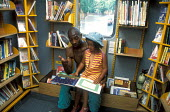 Father with his daughter in mobile library - Joanne O'Brien - 20021024