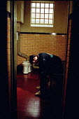 Young offender in police cell - Joanne O'Brien - 20021024