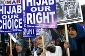 500 Muslim Women demonstrated outside the French Embassy in London 17.1.04 in protest against the French governments proposed ban on the wearing of the traditional headscarf or hijab. - Joanne O'Brien - 2000s,2004,activist,activists,against,BAME,BAMEs,ban,Black,BME,bmes,CAMPAIGN,campaigner,campaigners,CAMPAIGNING,CAMPAIGNS,DEMONSTRATING,DEMONSTRATION,DEMONSTRATIONS,diversity,dress,ethnic,ethnicity,FE