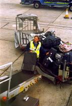 Baggage handler at airport - Joanne O'Brien - 20021024