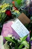 Kings Cross Station, central London. Flowers for those who died in the bombings in July 2005 - Joanne O'Brien - 09-07-2005