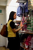 Young woman shopping for accessories in Gap - Joanne O'Brien - 2000s,2006,adolescence,adolescent,adolescents,BME Black minority ethnic,bought,buy,buyer,buyers,buying,cities,city,clothes,Commerce,commodities,commodity,consumer,Consumerism,consumers,customer,custom