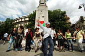 DABKE protest, Trafalgar Square London. Dabke is the name of the national Palestinian folklore dance Protesters expressing their frustration with the current deteriorating humanitarian situation in th... - Joanne O'Brien - 08-07-2006