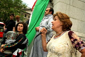 DABKE protest, Trafalgar Square London. Dabke is the name of the national Palestinian folklore dance. Pic shows protester speaking about the current deteriorating humanitarian situation in the Gaza St... - Joanne O'Brien - 08-07-2006