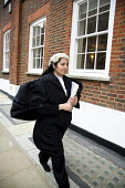 Poonam Bhari, barrister specialising in family law in the street en route to/from court, London. - Joanne O'Brien - 21-12-2006