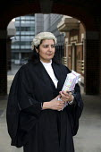 Poonam Bhari, barrister specialising in family law in the street en route to/from court, London. - Joanne O'Brien - 2000s,2006,Asian,asians,barrister,barristers,BME Black minority ethnic,cities,city,CLJ crime law & justice,counsel,court,families,family,FEMALE,justice,LAB LBR work ,lawyer,legal,litigation,people,per