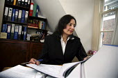 Poonam Bhari, barrister specialising in family law, in her chambers in London. - Joanne O'Brien - 2000s,2006,Asian,asians,barrister,barristers,BME Black minority ethnic,cities,city,CLJ crime law & justice,COMPUTE,computer,computers,COMPUTING,counsel,families,family,FEMALE,justice,LAB LBR work ,law