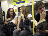 Passengers on the London Underground - Joanne O'Brien - 2000s,2007,adolescence,adolescent,adolescents,carriage,carriages,cities,city,communicating,communication,conversation,conversations,dialogue,discourse,discuss,discusses,discussing,DISCUSSION,EBF econo