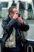 John Harris Photographer in action - Roy Peters - 01-04-2000
