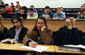 Students in a lecture theatre showing a decided lack of interest! - Roy Peters - 20-03-1997